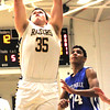 Photo by Chris Martin for The Herald Bulletin.  Cody Rudy puts a rebound back up for Shenandoah Saturday night against Centerville.