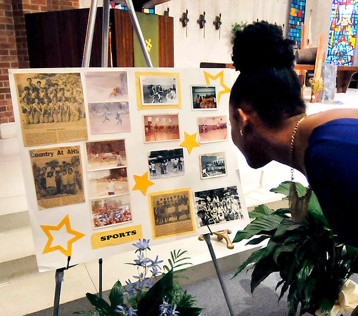 John P. Cleary |  The Herald Bulletin<br /> Visitors over some of the photographs that are displayed during the visitation   for Marietta Wright at First United Methodist Church Thursday.