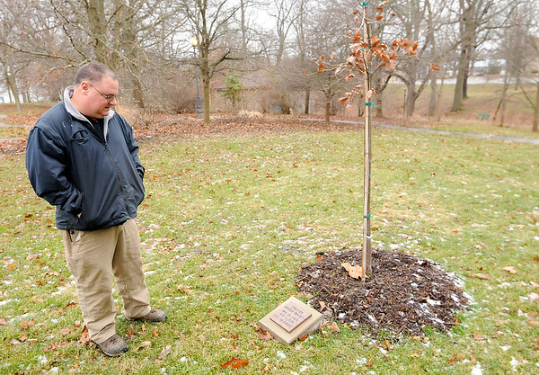 Don Knight | The Herald Bulletin<br /> Greg Spencer looks at a memorial tree planted in memory of Christine Harney-Bryant at Shadyside Park. You can buy a memorial tree to remember someone and the city will plant and care for the tree.