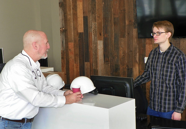 HB photo by Ken<br /> Purdue student Dakota Welker talks with Greg Winkler at new P3 facility.