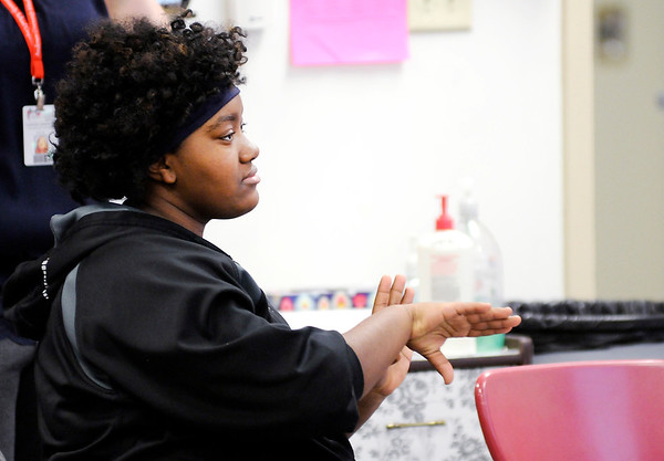 Don Knight | The Herald Bulletin<br /> Dyamond Johnson learns new vocabulary in her ASL class at Anderson High School. The high school offers ASL as a foreign language credit.