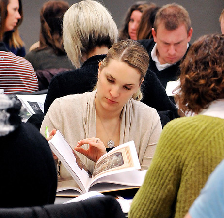 John P. Cleary |  The Herald Bulletin<br /> Indiana Historical Society holds a teacher workshop on Hoosiers and the American Story, a supplemental textbook. Here Hamilton Southeastern 9th-10th grade teacher Megan Allen looks through the book during the workshop.