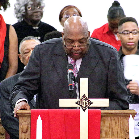 Mark Maynard   for The Herald Bulletin<br /> Reverand Manuel L. Hunt reads scripture from the Old Testament during the 38th Annual Dr. Martin Luther King, Jr. Service presented by the Concerned Ministers of Anderon.