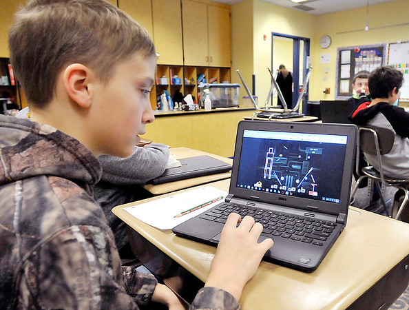 John P. Cleary    The Herald Bulletin<br /> Eastside Elementary student Triston Bybee, 11, runs through the Sumdog program on his computer in Julie Lallathin's 5th grade plus class. Bybee placed 5th in the nation in a Sumdog competition.