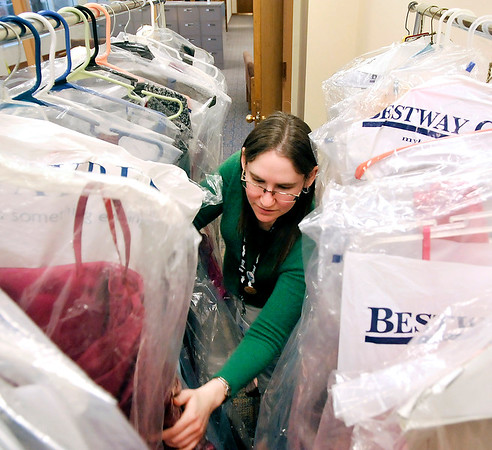 John P. Cleary    The Herald Bulletin<br /> Liz Osisek, teen services librarian for Anderson Public Library, with some of the prom dresses that have been donated for a prom outfit giveaway in March.