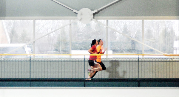 John P. Cleary |  The Herald Bulletin<br /> As the weather turned colder these AU students get their workout in by running around the jogging track on the second level of the Kardatzke Wellness Center Monday afternoon.