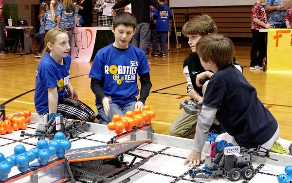 Competitors discuss their strategies prior to doing battle during the VEX I. Q. Challenge robotics tournament.