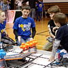 Competitors discuss their strategies prior to doing battle during the VEX I. Q. Challenge robotics tournament.
