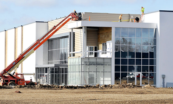 John P. Cleary    The Herald Bulletin<br /> Workers work on the roof of the new Italpollina fertilizer plant Friday that is being built at Scatterfield West next to Purdue Polytechnic.