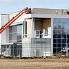 John P. Cleary |  The Herald Bulletin<br /> Workers work on the roof of the new Italpollina fertilizer plant Friday that is being built at Scatterfield West next to Purdue Polytechnic.