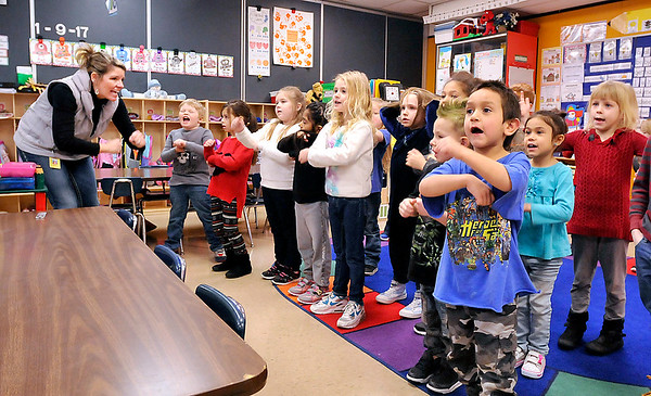 John P. Cleary    The Herald Bulletin<br /> Killbuck Kindergarten Extension teacher Jamey Knight leads her class in practicing sight words as they watch a video Monday.