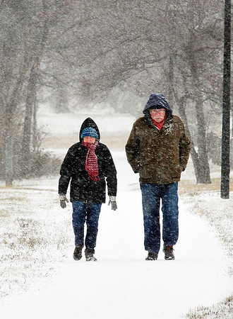 John P. Cleary |  The Herald Bulletin<br /> Kathy and Garth Closter don't let the snow and cold prevent them from bundling up and getting out to enjoy a walk around Shadyside Lake Thursday afternoon.