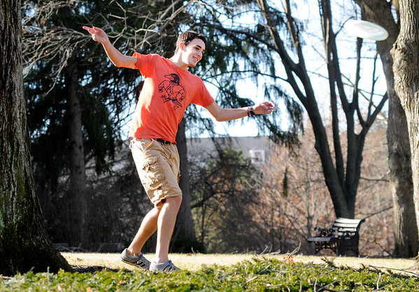 Don Knight | The Herald Bulletin<br /> Mechanical engineering student Ian Leatherman from Fishers takes advantage of Saturday's unseasonable warm and sunny weather to play a round of disc golf on campus. Colder temperatures are forecast to return in the week ahead.