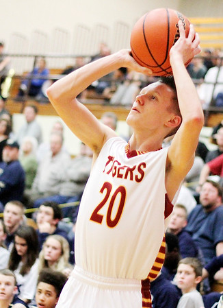 Chris Martin | For The Herald Bulletin<br /> Alexandria's Blake Morehead shoots a three pointer Friday night at home against Oak Hill.