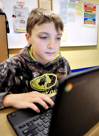 John P. Cleary |  The Herald Bulletin<br /> Eastside Elementary student Triston Bybee, 11, runs through the Sumdog program on his computer in Julie Lallathin's 5th grade plus class. Bybee placed 5th in the nation in a Sumdog competition.