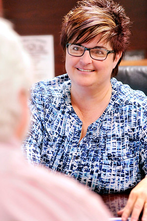 John P. Cleary |  The Herald Bulletin<br /> Christy Clark, administrative assistant to Elwood Mayor Todd Jones, works with Bill Savage, planning director for the city.