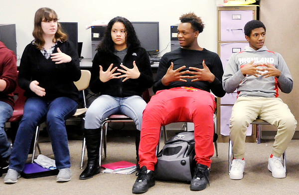 Don Knight   The Herald Bulletin<br /> Anderson High School students go over new vocabulary in their ASL class. ASL is the third most popular language in the U.S.