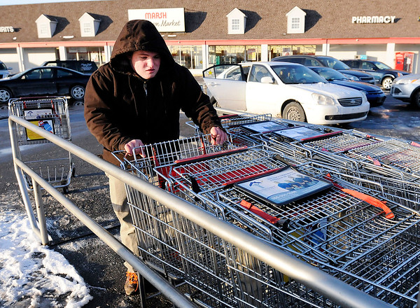 Don Knight | The Herald Bulletin<br /> Craig Bodey collects shopping carts to return them to the store at the Marsh on Nichol Avenue on Friday. Temperatures were in the single digets on Friday.