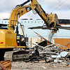 John P. Cleary |  The Herald Bulletin<br /> Workers for Watson's Excavating demolish the old radio station building in the 2000 block of West 53rd Street Wednesday. The old facility housed 97.9 WLHN FM and 1470 WHUT AM for many years until being bought by Moody Broadcasting in 1998 when they built new studios several years later.