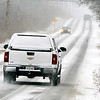 John P. Cleary |  The Herald Bulletin<br /> Light snow fell early Thursday making area roadways slick and hazardous like this stretch of South Rangeline Road north of White River.