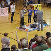 The celebration is on as two teams score bonus points by balancing both of their robots on the titling bridge simultaneously.