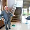 John P. Cleary |  The Herald Bulletin<br /> ACS Superintendent Terry Thompson looks over the end of one of the wings at Anderson High School where he proposes the exit be moved to the window area behind him from it's present location to the right behind the stairway. Students then could go straight  down the hall and out instead of having to turn and merge with students coming from the second floor trying to exit.