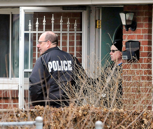 John P. Cleary    The Herald Bulletin<br /> Police surround house in 2200 block of Halford Street in Anderson to serve warrant on felony suspect Wednesday morning. SWAT officers were called and the suspect exited the house without incident.