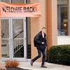Don Knight | The Herald Bulletin<br /> Anderson University student Levi Armentrout passes under a welcome back banner as he leaves Hardacre Hall on Thursday. Spring semester classes started on Wednesday.