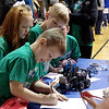 Cayden Anderson signs in the Pleasant View Elementary School Robotics Team for the VEX I. Q. Challenge robotics tournement held at Frankton Elementary School on Sunday.