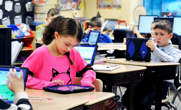 John P. Cleary |  The Herald Bulletin<br /> Eastside Elementary student Jaci Reed, foreground, runs through the Sumdog program with her classmates in Dawnelle Sachse's 4th grade plus class. Reed placed 12th in the nation in a Sumdog competition.