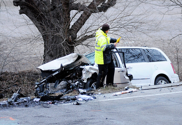 Don Knight | The Herald Bulletin<br /> A minivan sits in the ditch along Indiana 32 after being involved in a head on collision on Thursday.