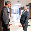 John P. Cleary |  The Herald Bulletin<br /> ACS Superintendent Terry Thompson, right, talks with AHS teacher Paul Partezana outside his classroom about his plan to move the exit doors at the end of the wing straight out.