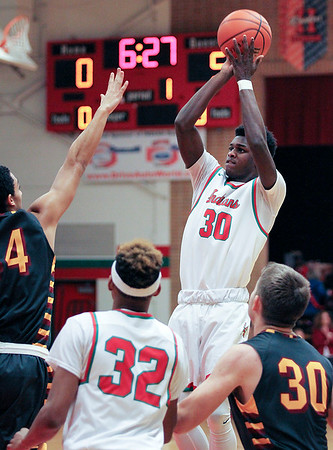 Chris Martin   for The Herald Bulletin<br /> Anderson's Zakarius Milhouse takes a jumpshot Friday night at home against McCutcheon.