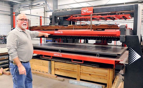 John P. Cleary | The Herald Bulletin  FILE PHOTO<br /> Chris Barkdull, president of CB Fabricating, shows part of their latest piece of equipment, a precision laser cutter that is fully automated with load and unload capabilities.