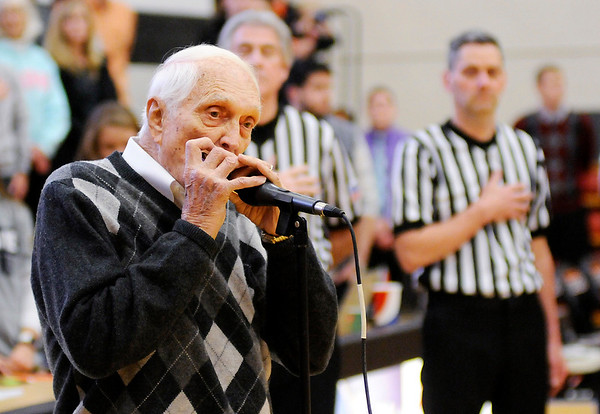 Don Knight   The Herald Bulletin<br /> Carl Erskine plays the national anthem on his harmonica before tip off as Anderson University hosted Franklin College on Saturday.