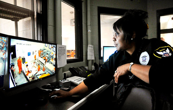 John P. Cleary    The Herald Bulletin<br /> Madison County Community Corrections officer Celia Calhoun monitors the two inmate dormitories directly through windows and by cameras as well as a separate trustees dormitory by cameras from the central control room in the new facility.