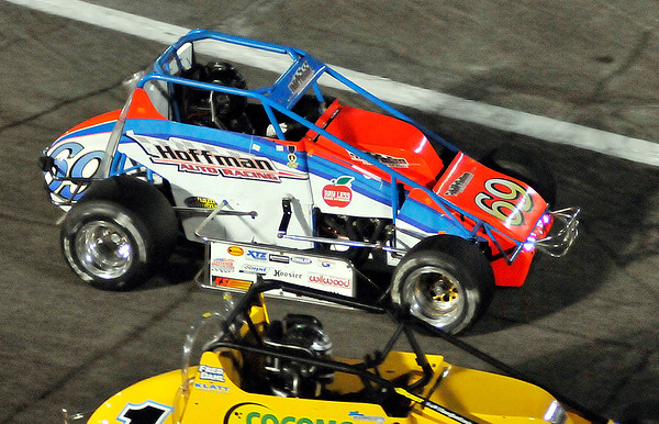 John P. Cleary | for The Herald Bulletin   FILE PHOTO<br /> Kody Swanson passes a car going into turn one and goes on to win the 2016 Pay Less Little 500 sprint car race in Hoffman Auto Racing No. 69 sprint car.