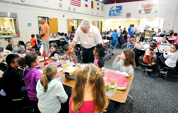 John P. Cleary |  The Herald Bulletin<br /> Tenth Street Elementary School Principal David Suchocki talks to first graders as they eat their lunch in the crowded school cafeteria.