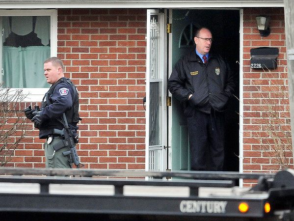 John P. Cleary |  The Herald Bulletin<br /> Police surround house in 2200 block of Halford Street in Anderson to serve warrant on felony suspect Wednesday morning. SWAT officers were called and the suspect exited the house without incident.