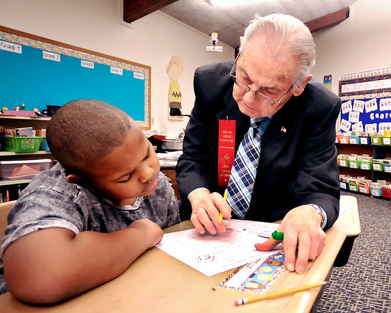 John P. Cleary |  The Herald Bulletin<br /> Valley Grove Elementary student Da'arrion Cooley listens as Bob Ivy helps him with his math problem Tuesday during Heather Simth's 4th grade class. Ivy celebrated his 90th birthday by going back into the classroom to teach math and to be with the kids.  Ivy worked 44 years as a teacher and then subbed for another 20 years