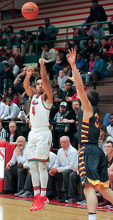 Chris Martin | for The Herald Bulletin<br /> Anderson's Ethen Russell attempts a three pointer Friday night at home against McCutcheon.