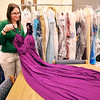 John P. Cleary |  The Herald Bulletin<br /> Liz Osisek, teen services librarian for Anderson Public Library, shows one of the prom dresses that have been donated for a prom outfit giveaway in March.