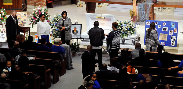 John P. Cleary |  The Herald Bulletin<br /> Visitors pay their respects during visitation for Marietta Wright at First United Methodist Church Thursday.