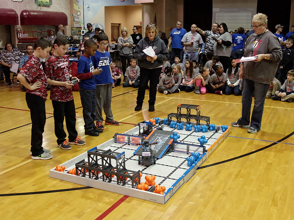 Robotics competitors Sam and Max Barr of the Frankton Elementary Cyborgs square-off against Heritage Christian's Kamal Taylor and Seth Buening in the VEX I. Q. Challenge.