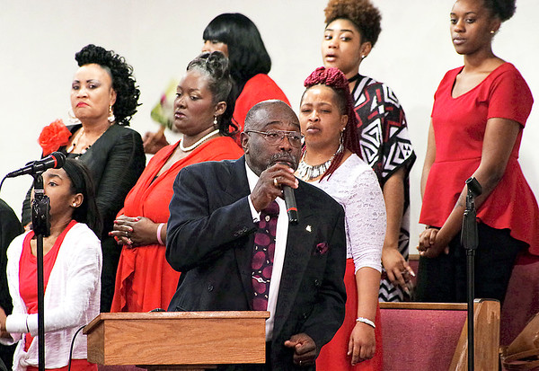 Mark Maynard | for The Herald Bulletin<br /> Pastor Edgar Woodall joins the Community Choir in a song of praise during the 38th Annual Dr. Martin Luther King, Jr. Service on Sunday at the Bethesda Baptist Church.