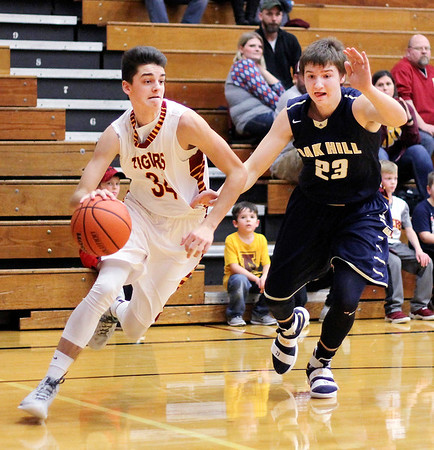 Chris Martin | For The Herald Bulletin<br /> Alexandria's Avery Paddock drives the baseline Friday night at home against Oak Hill.