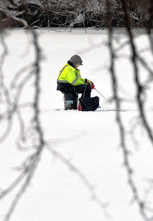 John P. Cleary | The Herald Bulletin<br /> With the temperatures just above zero and the wind-chill well below that, this fisherman braves the elements Tuesday being out on the open ice of Shadyside Lake with his back to the wind patiently waiting for that bite on the line.