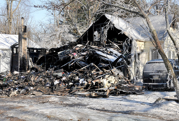 John P. Cleary | The Herald Bulletin<br /> This is what remains of the back of this structure on Grandview Drive in Camp Chesterfield after an overnight fire early Wednesday.