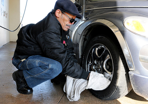 Don Knight |  The Herald Bulletin<br /> Al Coates Sr. takes advantage of the break in the winter weather Thursday to clean his '02 PT Cruiser at the Wash Tub on Broadway. The forecast is calling for rain Saturday and a chance for flurries to return on Monday.