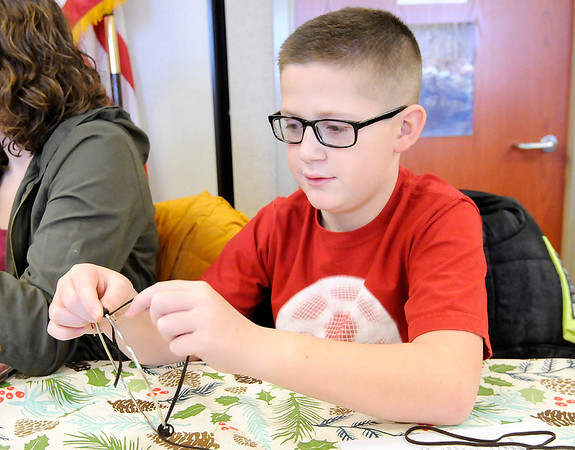 Don Knight |  The Herald Bulletin<br /> Jamison McDole, 11, from Lapel creates a dream catcher during a workshop at Mounds State Park on Saturday.
